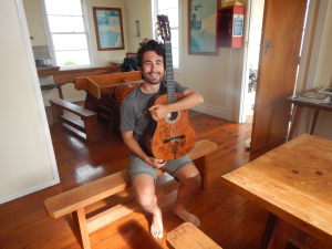 Lindsay with his guitar at Cape Brett hut.